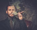 Wwell dressed man smoking cigar handsome well with Stock Images