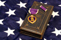 WWII Purple Heart on American Flag Royalty Free Stock Photo