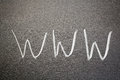 Www world wide web the abbreviation for handwritten with white chalk on a blackboard Royalty Free Stock Image