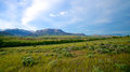 Wyoming landscape rolling plains and ranch land gives way to the edge of the rocky mountains Stock Photography