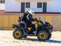 X atv on beach people with all terrain vehicle Stock Images