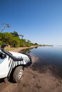 X car at chobe white the muddy bank of river front national park botswana africa Royalty Free Stock Image