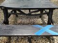 An & x22;x& x22; is painted blue on a park bench. Social distancing concept. Covid19. Royalty Free Stock Photo
