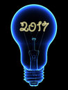 X-Ray lightbulb with sparkling 2017 digits inside isolated on black Royalty Free Stock Photo