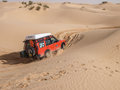 X vehicle drives around the sand dunes of the sahara desert tunisia october vehicles navigate as part a guided tour on october Stock Photo