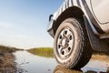 X on wet trail left wheel of a white car a in the marsh of nata bird sanctuary botswana africa Royalty Free Stock Photos