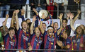 Xavi hernandez lifts the uefa champions league trophy barcelona players pictured during award ceremony held after final between Stock Image