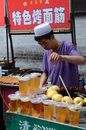 Xian street food stand muslim quarter local people cooking on the streets of china Royalty Free Stock Images