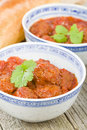 Xiu mai vietnamese spicy pork meatballs in fragrant tomato sauce Royalty Free Stock Photography
