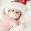 Xmas baby with santa claus cap Stock Image