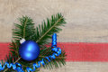 Xmas ball blue on red ribbon Stock Photos