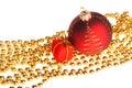 Xmas ball and present box lying on yellow beads Royalty Free Stock Photo