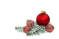Xmas ball red on fir branch Royalty Free Stock Photo