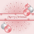 Xmas balls and sunburst pink Royalty Free Stock Photography