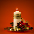 Xmas a beautiful ornated christmas centerpiece with a lit white candle Royalty Free Stock Images