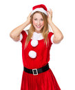 Xmas girl adjust the hat on white background Royalty Free Stock Photography