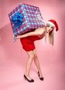 Xmas girl with gift Stock Photos