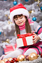 Xmas girl a little getting a christmas gift Stock Photo
