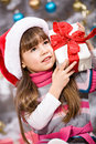 Xmas girl a little getting a christmas gift Royalty Free Stock Images