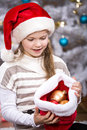 Xmas girl a little getting a christmas tree decoration Royalty Free Stock Images