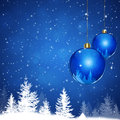 Xmas land winter blue snow background with balls and forest Stock Photo