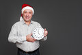 Xmas man showing the clock Stock Image