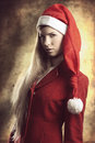 Xmas portrait of fashion blonde girl close up woman with long blond hair and style she posing with elegant red coat and funny Stock Photography