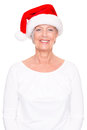 Xmas time senior woman with cap in front of white background Stock Photos