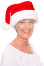 Xmas time senior woman with cap in front of white background Royalty Free Stock Images