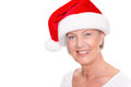 Xmas time senior woman with cap in front of white background Stock Photography
