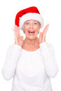 Xmas time senior woman with cap in front of white background Stock Image