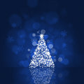 Xmas tree and bokeh lights holiday blue background with Royalty Free Stock Images