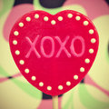 Xoxo hugs and kisses picture of a heart shaped lollipop with the text written in it with a retro effect Royalty Free Stock Photography