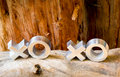 Xoxo hugs and kisses symbols on a rustic wooden background with copy space Stock Photography
