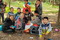 Yaan china young boys spring outing in the zhangjia mountain park in some are eating the foods have a group photo taken to mark Royalty Free Stock Image