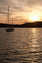 Yacht on anchor in the bay Stock Photography