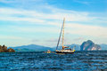 Yacht on the background of blue sea waves sea horizon sea cliffs and cloudy blue sky palawan island philippines Royalty Free Stock Image