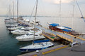 Yacht club over blue nature scene row of luxury sailboats reflected in water Royalty Free Stock Image