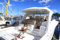 Yacht with a fishing chair sanctuary cove international boat show queensland australia Royalty Free Stock Image