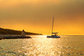 Yacht getting ready to be moored in the harbor of a small town Postira - Croatia, island Brac Royalty Free Stock Photo