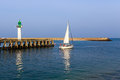 Yacht and lighthouse in the city of Deauville, Normandy, France Royalty Free Stock Photo