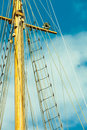 Yacht mast against blue summer sky. Yachting Royalty Free Stock Photo