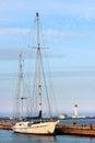 Yacht moored to a pier at sea marina Royalty Free Stock Photo