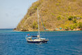 A yacht motoring into admiralty bay, bequia Royalty Free Stock Photo