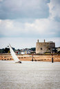Yacht navigating the river under sail Royalty Free Stock Photo