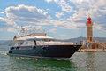 The yacht near St. Tropez Lighthouse Royalty Free Stock Photo