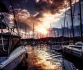 Yacht port on dramatic sunset background mysterious cloudscape active lifestyle luxury water transport summer sport travel and Stock Image