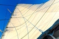 Yacht sail billowing the main of a sailboat in the sunshine Stock Photo