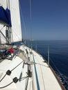 Yacht sailing blue sky sea horizon Royalty Free Stock Photo