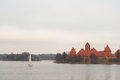 Yacht sailing at lake near Trakai Peninsula Castle Museum on the island. Village of Karaites, Lithuania, Europe. Lithuanian landma Royalty Free Stock Photo